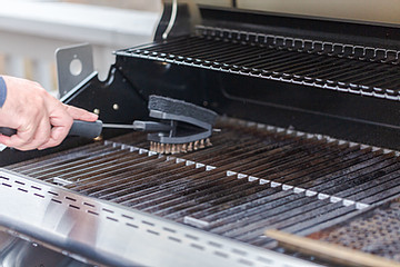 Cleaning a grill with brush